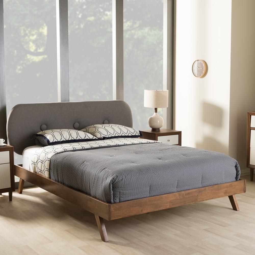 Baxton studio penelope mid century modern solid walnut wood grey fabric upholstered king size platform